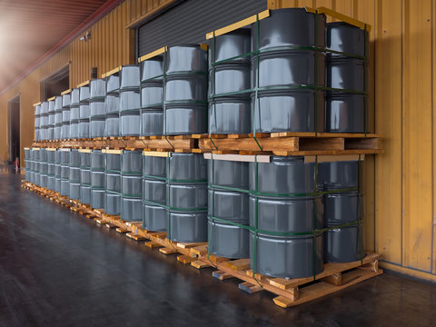 Gray oil drums on pallet stacking  in front of  industrail warehouse