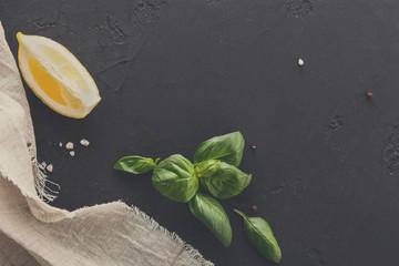 Lemon with mint on black background