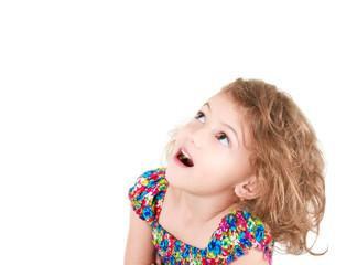 amazed little girl looking up