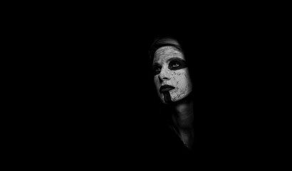 Portrait of a girl in a mystical makeover. The concept of black color. Black and white photography