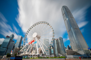 Wall Mural - Observation Wheel in Hong Kong City skyline at sunrise. View from across central district Hongkong.