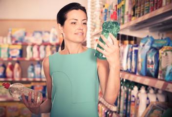 Adult woman choosing dishwashing liquid