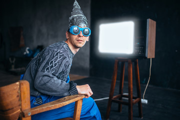 Man in tinfoil helmet and hypnotizing glasses, UFO