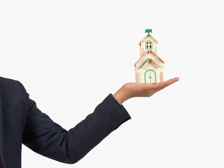 Man hand holding a home model on isolate white background , Real estate concept