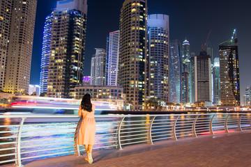 Girl enjoying Dubai marina view at night