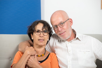 Happy mature couple in love, in their home