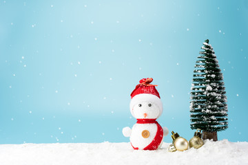 Christmas tree and snowman on snow