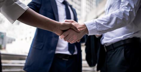 handshake of business People Teamwork Meeting .group business people Hold hand and shake hand in city