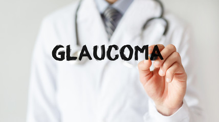 Doctor writing word GLAUCOMA with marker, Medical concept