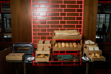 Fresh French baguettes bread in a wooden boxes in bakery