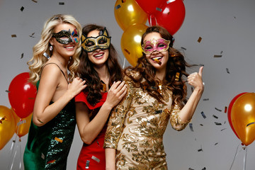 Party. Beautiful Women In Masks Celebrating New Year