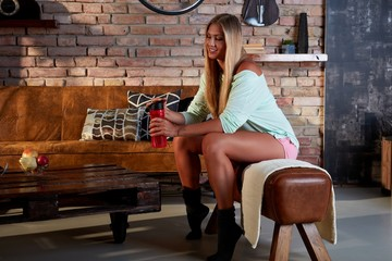 Blond woman at home ready for training