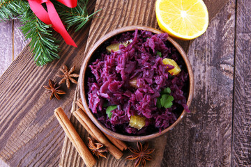 Red Cabbage salad with orange and pecan nuts for Christmas dinner. Vegetarian dish