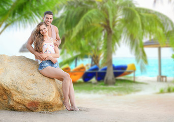 Young couple on beach at tropical resort
