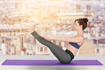 Young woman practicing yoga on white background