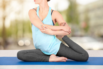 Young woman practicing yoga on white background, closeup