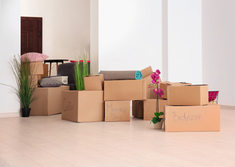 Moving boxes with stuff in room