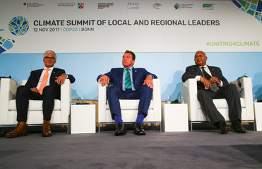 Mayor of Bonn Ashok-Alexander Sridharan, Former California governor and 'Mr. Universe' Arnold Schwarzenegger and COP 23 President Prime Minister Frank Bainimarama of Fiji attend the COP23 UN Climate Change Conference 2017, hosted by Fiji but held in Bonn