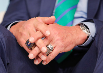 Former California governor and 'Mr. Universe' Arnold Schwarzenegger's rings are seen on his hand as he attends the COP23 UN Climate Change Conference 2017, hosted by Fiji but held in Bonn