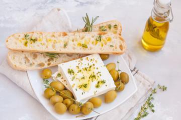 Green olives, feta cheese and fresh ciabatta