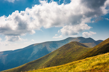 rolling hills of Borzhava mountain ridge in summer. wonderful nature background with grassy slopes under the cloudy sky