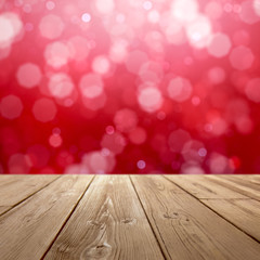 Christmas holiday background with rustic table top over red bokeh for product display