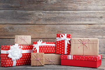 Gift boxes with ribbon on grey wooden table