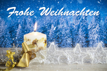 "Christmas decoration with candle, golden bow, silver stars, with text in German ""Frohe Weihnachten"" in a blue forest background"