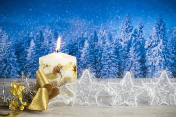 Christmas decoration with candle, golden bow, silver stars, with copyspace