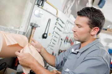 mechanic wiping hands