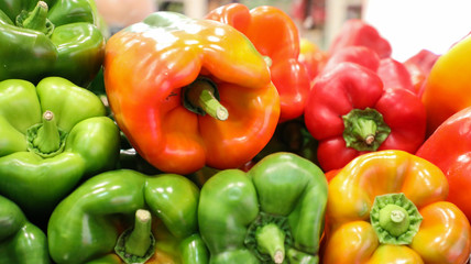 Green, orange, red and yellow bell peppers.