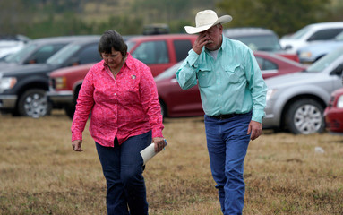 A couple leaves the First Baptist Church of Sutherland Springs worship service, the first service since a gunman opened fire inside the small church a week earlier in Sutherland Springs