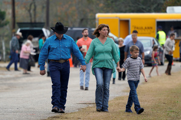 A family leaves the First Baptist Church of Sutherland Springs worship service, the first service since a gunman opened fire inside the small church a week earlier in Sutherland Springs