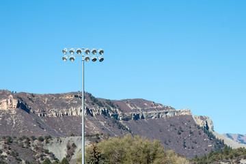 Stadium lights and hills in Durango, Colorado at a baseball field