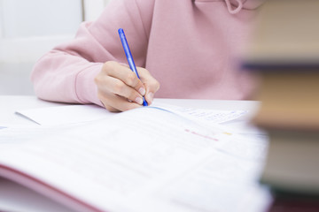 child's hand closeup writing