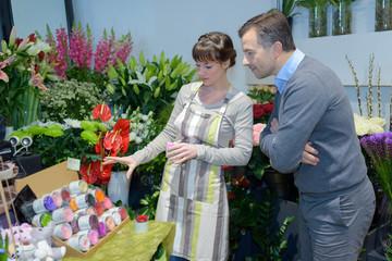 Florist showing color range to customer