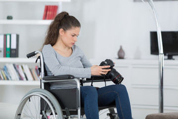 handicapped female photographer takes images with dslr camera