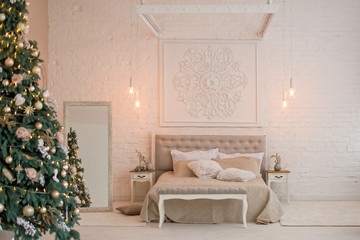 New Year's interior. Christmas tree bed with soft blue back and decorative pillows, large floor mirror. Concept happy Xmas