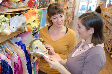 woman shopping at toys store with friend