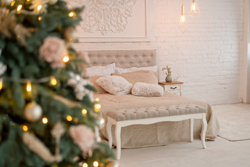 New Year's interior. Christmas tree bed with soft beige back and decorative pillows. Concept happy Cristmas