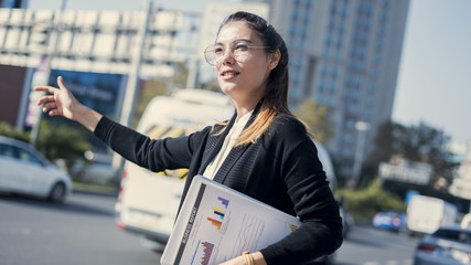 Wall Mural - Young businesswoman calls a taxi