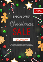 Special offer Christmas Sale. Vertical Discount flyer, big seasonal sale. Web banner with holiday sweets- lollipops, candy cane, cookies, gingerbread Man. Xmas Greeting Card on black wooden background