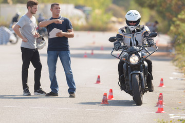 man motorcyclist passing his motorbike test