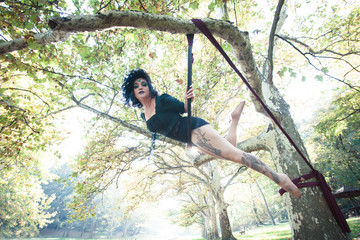 woman aerial hoop  dance in forest