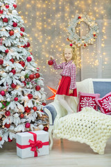 Christmas xmas casual gold studio decorations with cute girl and huge mirror with golden frame plenty presents and big green pine tree
