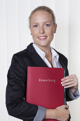 woman with application folder