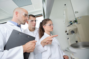 Science teacher instructing students