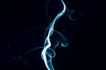 Swirls of blue smoke on a black background
