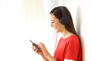 Profile of a girl listening to music on line on white