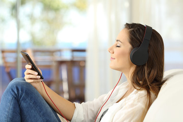 Profile of a woman relaxing listening music
